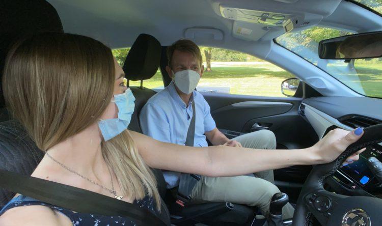 https://www.intelligentinstructor.co.uk/wp-content/uploads/2021/06/instructor-learner-face-masks-talking-scaled.jpg